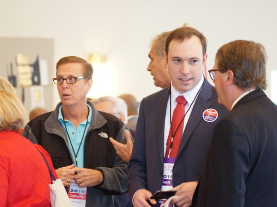 Joe Uddo, right, a campaign staffer for the Donald Trump presidential campaign, listens at the Delaware GOP convention in Dewey  Beach on Saturday, April 30, 2016.