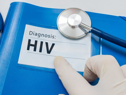 HIV diagnosis on blue folder with stethoscope.