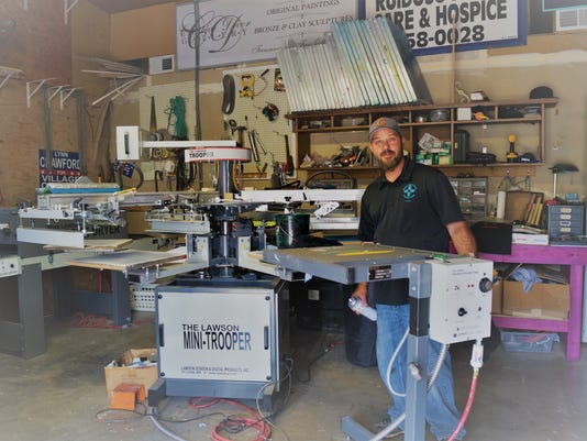 Tommy McCarty working with printing equipment
