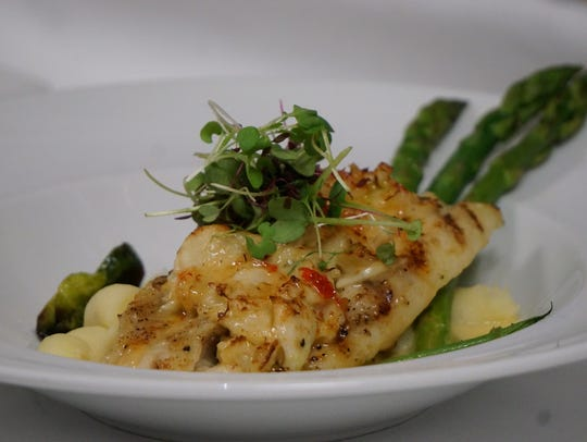A signature dish at Il Cielo is local black grouper