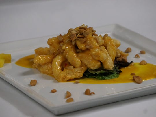 The calamari in a sweet chili aioli with cashews and