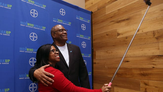 Former outfielder for the Cincinnati Reds, Ken Griffey Sr. takes a selfie with employee Loretta Nobles-Cherry during a World Cancer Day event at Bayer in Whippany. February 3, 2016, Whippany, NJ.