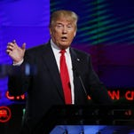 Donald Trump speaks during the Republican presidential debate sponsored by CNN, Salem Media Group and the Washington Times at the University of Miami on Thursday, March 10, 2016, in Coral Gables, Fla.