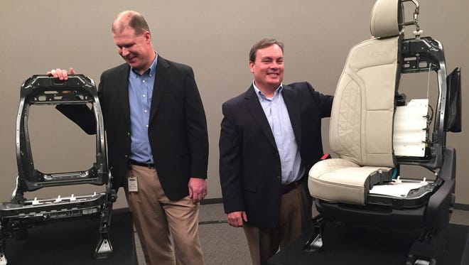 Jonathan Line (left) and Dan Ferretti, technical experts working on Ford's  global seat program, show cutaways of the seat for the 2016 Ford Explorer on Tuesday, Nov. 10, 2015.