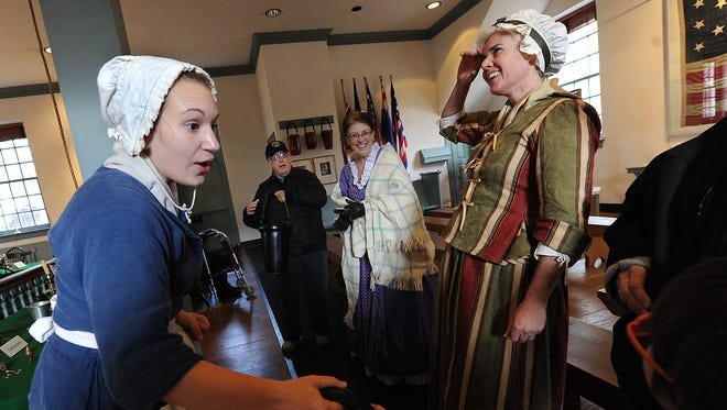 Lauren Ross, left, and Dara Kane, right, dress in period garb from the mid-1700s at the Colonial Courthouse in York.  The Continental Congress, while seated in York, declared a national day of Thanksgiving in 1777. Some say that was the first Thanksgiving as a new nation.
