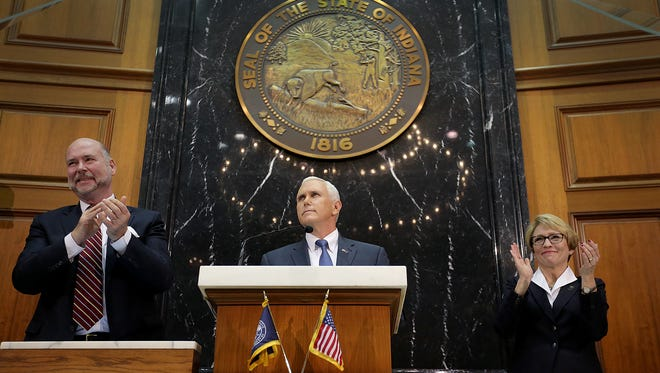 House Speaker Brian Bosma, left, and Lt. Gov. Sue Ellspermann applauded during Gov. Mike Pence's State of the State address Tuesday, Jan 12, 2016.