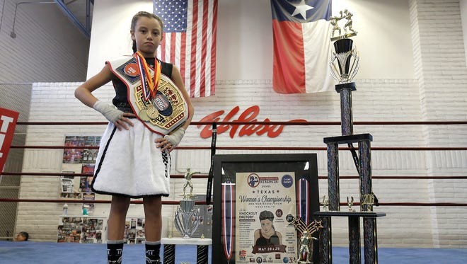 Ivy Enriquez shows the many trophies and accolades she's acquired in under two years as a boxer.
