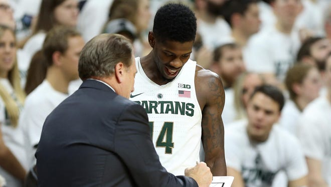 Michigan State coach Tom Izzo talks to guard Eron Harris (14) during the first half Friday at Breslin Center.
