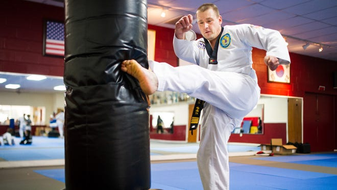 Robert Zerance, 39, a fourth-degree black belt, practices kicks during a lesson at So's Tae Kwon Do in Hanover on Saturday, Jan. 21, 2017. Zerance has a neurological disability and limited motion of his left hand but has maintained a dedication to the martial arts for years.