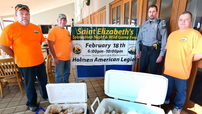 Warden Dale Hochhausen (in uniform) dropped off about 800 illegally bagged panfish for the St. Elizabeth's Sportsmen Night and Wild Game Feed. The group used part of the proceeds from the church's annual fee for the Holmen church's programs including the local food pantry, community and youth groups. The rest of the fish were taken to other area nonprofits.