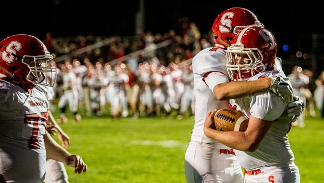 Susquehannock's Daniel Clapp (31) and Chris Norris (1) embrace after Clapp's touchdown against York Catholic in a YAIAA football game on Friday, Sept. 8, 2017.