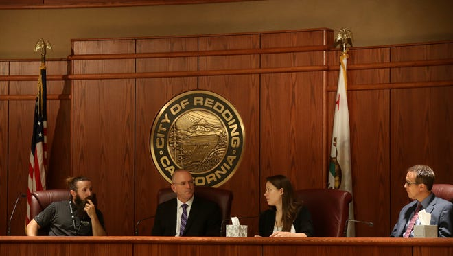 (From left) Marijuana business owner Cody Davis, Redding City Attorney Barry DeWalt, Plant Scientist at Steep Hill Labs Lydia Abernethy and Redding's Development Services Director Larry Vaupel discuss marijuana businesses at a  panel on Monday at the Redding City Council Chambers.