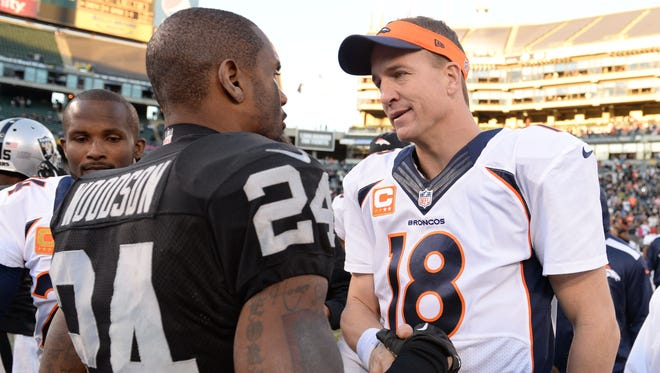 Raiders S Charles Woodson (24) has never picked off Peyton Manning.