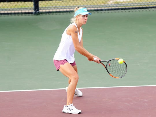Eula's Anna Masonheimer lines up a backhand during her 6-0, 4-6, 6-2 victory at the Class 1A girls singles final at the UIL state championships.
