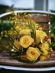 A sunny bouquet with yellow roses created by Tove's
