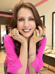 Erica Courtney poses with some of her jewelry designs