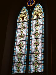 Original stained-glass windows and other historic touches