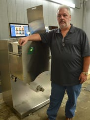 Obie Hulin stands by his new label printing machine,