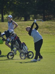 Shelby's Julia Gutchall hits an approach shot during