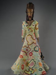 'Pretty Girl Veiled' is a sculpture by Joyce J. Scott,