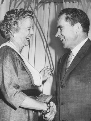 Richard Nixon chats with Judy Weis of Rochester at a breakfast in Chicago during the Republican National Convention in 1952.