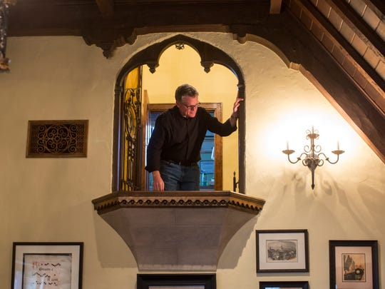 """Cincinnati Pops conductor John Morris Russell and his wife Thea Tjepkema, live in a Tudor Revival home in Hyde Park. One of the things they loved about the house was the Juliet balcony in the large vaulted living room. When they entertain for the orchestra's """"Parties of Note"""" fundraising events, Russell said the balcony has the best seats in the house."""