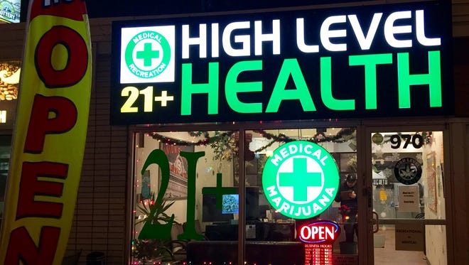 A marijuana store in Denver advertises its offerings Wednesday, Dec. 17, 2014. Colorado is now home to hundreds of marijuana stores selling recreational marijuana to adults.