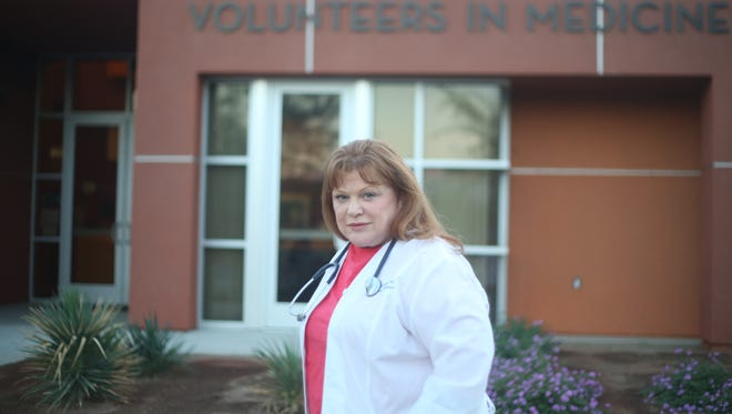 Rosa Lucas, a volunteer at Coachella Valley Volunteers In Medicine is photographed outside their building.
