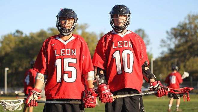Leon sophomore Shane Shively, left, and senior Danny Manausa come from Leon hall of fame football families. The pair are cornerstones for the Lions' lacrosse program.