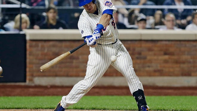 The Mets' Taylor Teagarden hits a grand slam home run during the sixth inning on Tuesday night.