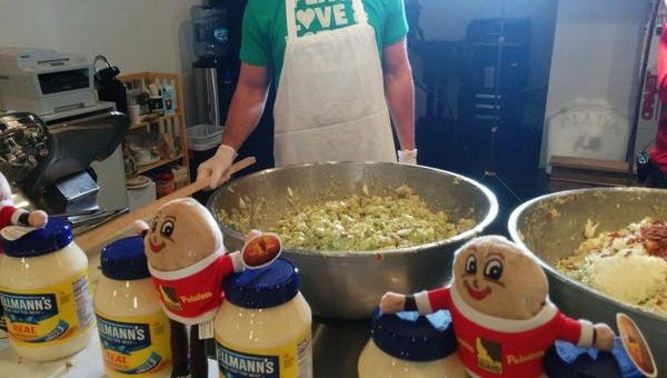 Brown makes potato salad for the big party.