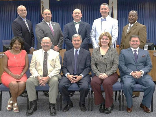 The Lafayette Parish School Board is pictured with