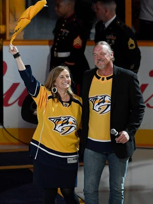 Nashville Mayor Megan Barry, the team's 7th fan, and Trace Adkins, who performed the National Anthem, wave to fans before the home opener at Bridgestone Arena in Nashville, Tenn., Tuesday, Oct. 10, 2017.