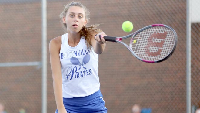 Boonville senior Molly Amos hits a forehand while playing No. 1 doubles with teammate Emma Neidig Thursday night at the high school tennis courts. Amos and Neidig won their match over Osage's No. 1 doubles team 8-2. However, it was the Lady Indians with the team win over Boonville 7-2.