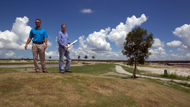 Lennar Homes Project Manager Scott Edwards and Director of Land Development Russ Smith stand on a hill near the 15th green at the Bonita National Golf and Country Club's under-construction golf course