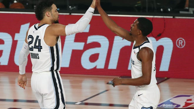 Memphis Grizzlies guards Dillon Brooks (24) and guard De'Anthony Melton were able to celebrate their first win in the NBA bubble with a 121-92 rout of the Oklahoma City Thunder on Friday in Lake Buena Vista, Fla.