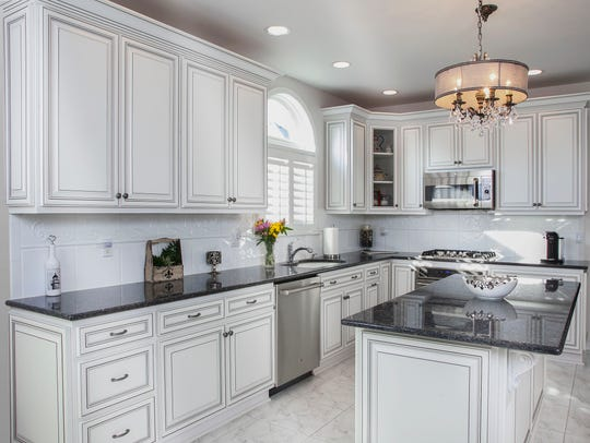 This refaced kitchen is in a traditional Vintage style