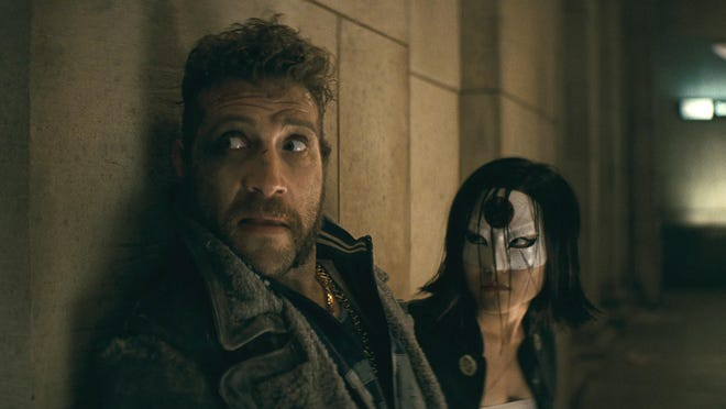 "Jai Courtney and Karen Fukuhara in ""Suicide Squad."""