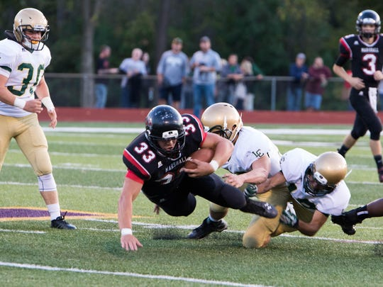 Marshall running back Chris Upright gets brought down against Lumen Christi at Albion College on Friday.