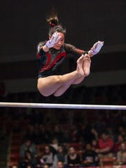 Kirsten Yee and the SUU Flippin' Birds compete in a meet against BYU and Sacramento State.