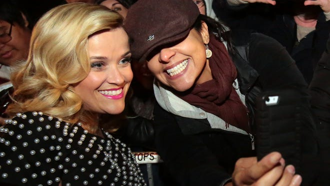 Palm Springs resident Jeannette Ramos takes a selfie with Reese Witherspoon before the Palm Springs International Film Festival gala January 3, 2015 outside the Palm Springs Convention Center in Palm Springs, Calif.