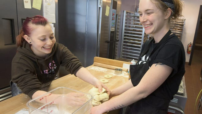 Glazin' baker/managers Rachel Gibson and Kristen Keezel, left, gather doughnut holes while making doughnuts at the York City eatery Monday, Feb. 1, 2016. Restaurant Week organizers revealed menus for the event which runs Feb. 20-27, during a press conference at the participating restaurant. Bill Kalina photo
