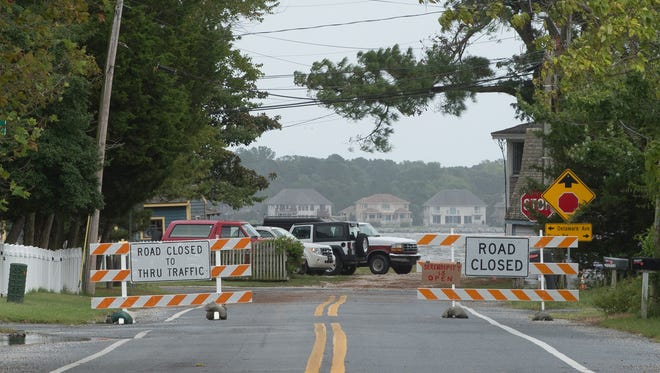 View of road closed sign as you enter Oak Orchard, east of Millsboro, as Tropical Storm Hermine moves off the coast of Delaware.