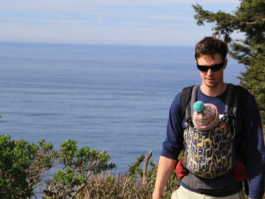 Zach Urness hikes with his 5-month-old daughter Lucy