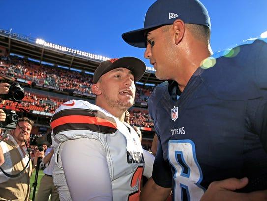 Marcus Mariota (8) talks with Browns quarterback Johnny