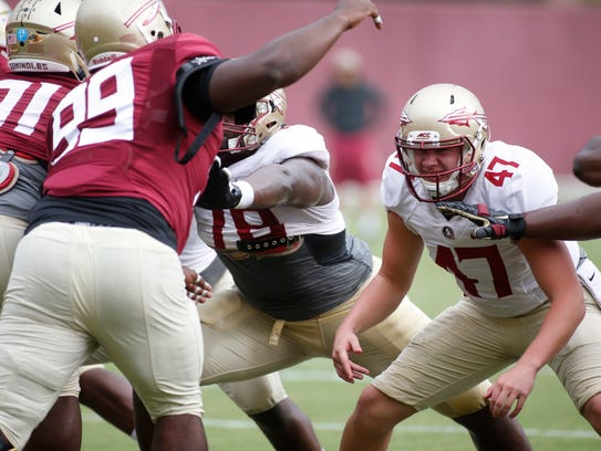 Stephen Gabbard, right, works out at FSU's Dunlap Training