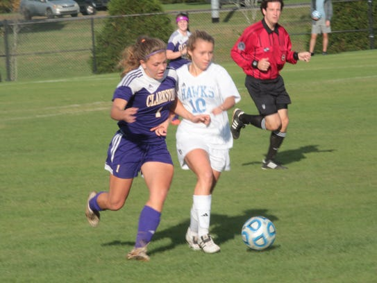 Clarksville High's Gybson Roth (1) tries to sprint