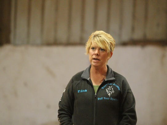 Trina Phipps instructs riders at the Horsin' Around