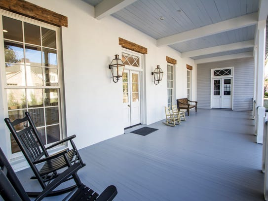 The front porch of the home offers old Louisiana style