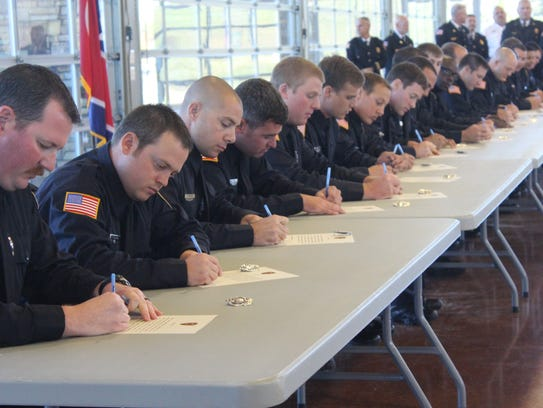 21 recruits sign their pledges before taking their